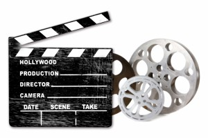 761699-empty-hollywood-film-canisters-and-clapper-on-white